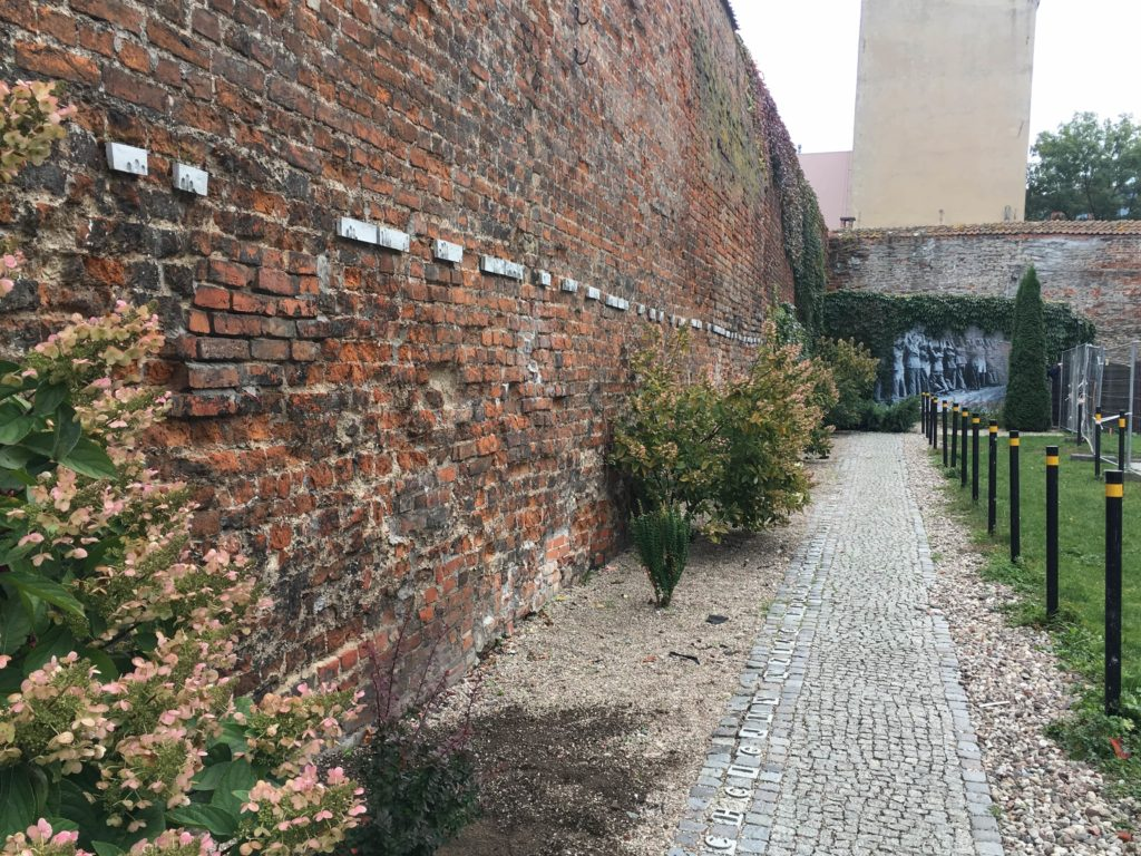 The wall outside the Post Office with fingerprint  plaques showing where the captured postal workers were forced to stand with their hands against the wall
